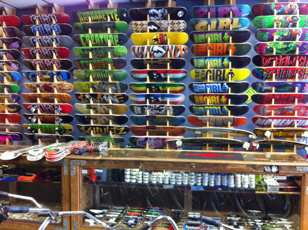 Skateboards on racks at momentum ride shop